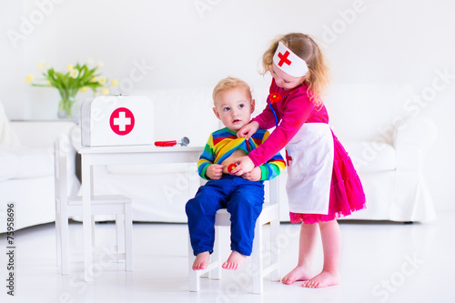 Kids playing doctor - 75958696