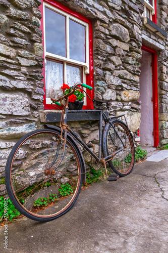 Old rusty bike at Irish cottage house - 75960052