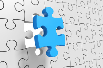 Puzzle solution, final jigsaw piece being inserted