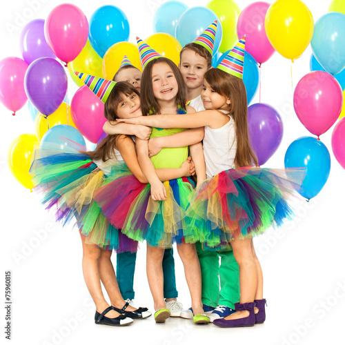 Zdjęcia na płótnie, fototapety, obrazy : Group of joyful little kids having fun at birthday party