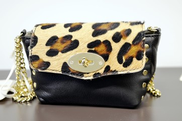 Fashion leopard handbag with gold chain on fashion store