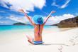 Leinwanddruck Bild - Woman in hat enjoying sun holidays on the tropical beach