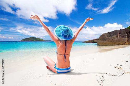 Leinwandbild Motiv Woman in hat enjoying sun holidays on the tropical beach