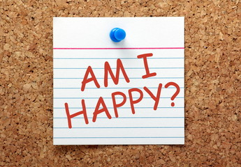 The question Am I Happy on a cork notice board