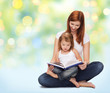 happy mother with adorable little girl and book