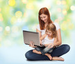 happy mother with adorable little girl and laptop