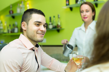 Couple with wine at bar
