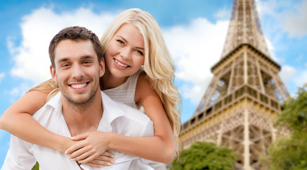 happy couple having fun over eiffel tower