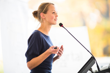 Pretty, young business woman giving a presentation
