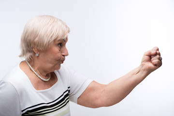 Elderly lady showing her fist