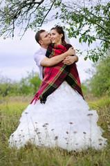 newlyweds in a garden