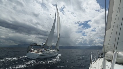 Sailing in the wind through the waves at the Aegean Sea.