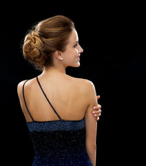smiling woman in evening dress from the back