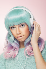 Gorgeous modern teenage girl with headphones in pastel colors