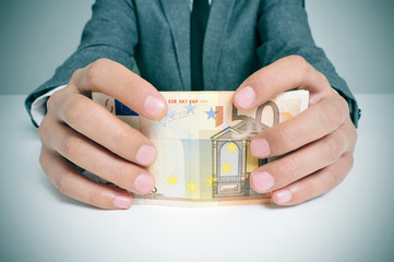man in suit with euro bills
