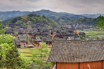Wooden houses of farmers in the mountain village agricultural Ch