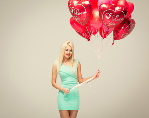 Sexy blond woman with balloons