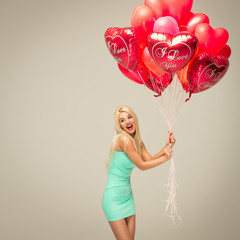young cheerful blond woman with red balloons