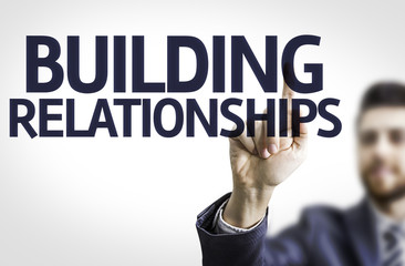 Business man pointing the text: Building Relationships