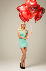 Blond beauty with red balloons