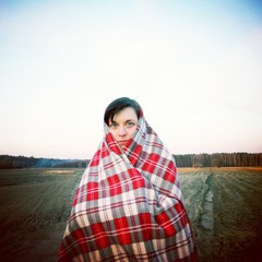 Cold weather woman wrap field