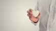 Retro image of a man holding a white heart