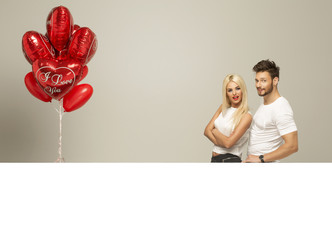 Valentines photo of loving couple with white board and red ballo
