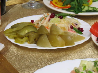 Pickled cucumbers, tomatoes and cabbage are decorated with cranb