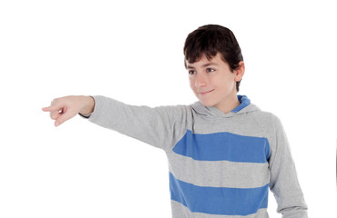 Casual young teenager pointing with his finger