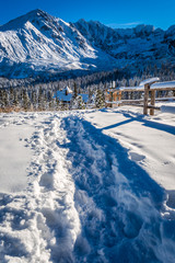 Snowy path to the winter shelter in the mountains