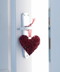 Red heart on a white door, a secret room