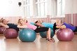 Pilates exercise with fitness balls - 75972274