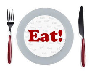 Plate with text on it, fork and knife on tablecloth background
