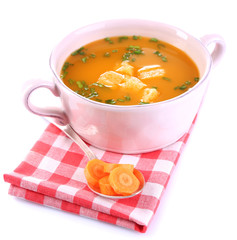 Carrot soup isolated on white