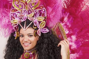 Beautiful samba dancer wearing pink costume and smiling