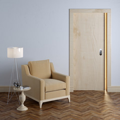 Textile beige armchair and wooden door in classic interior
