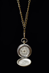Pocket watch on a long chain.