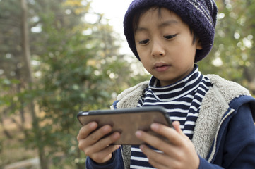 Boy playing a game on a mobile terminal