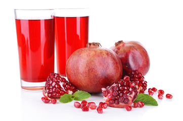 Ripe pomegranates with juice isolated on white