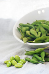 boiled green soybeans on fabric background