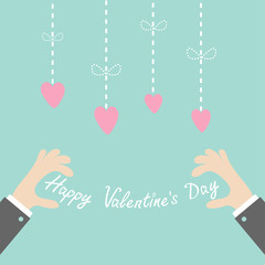Hands holding Happy Valentines day text Hanging dash line hearts