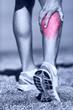 Muscle injury - Man running clutching calf muscle