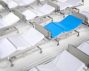 White hospital beds - blue stands out