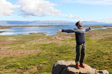 Freedom man in nature on iceland happy