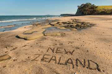 New Zealand handwritten in sand