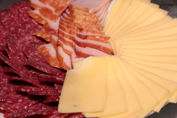 Pieces of sausage and cheese as an element of food