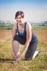 Smiling beautiful plus size woman in sportswear outdoor