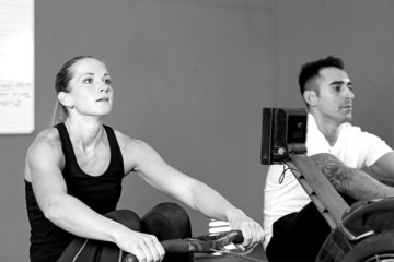 couple on rowing machine - crossfit workout