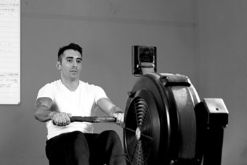 man on rowing machine - crossfit workout.