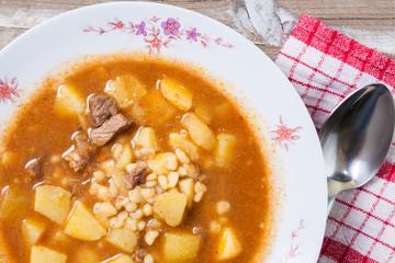 Traditional Hungarian goulash, top view and closeup